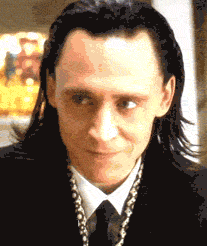 "Loki grins as he ""stabs"" a man in the eye."