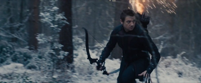 Hawkeye runs through what looks like the Forrest surrounding Baron Strucker's castle in what is likely Germany or another European country.