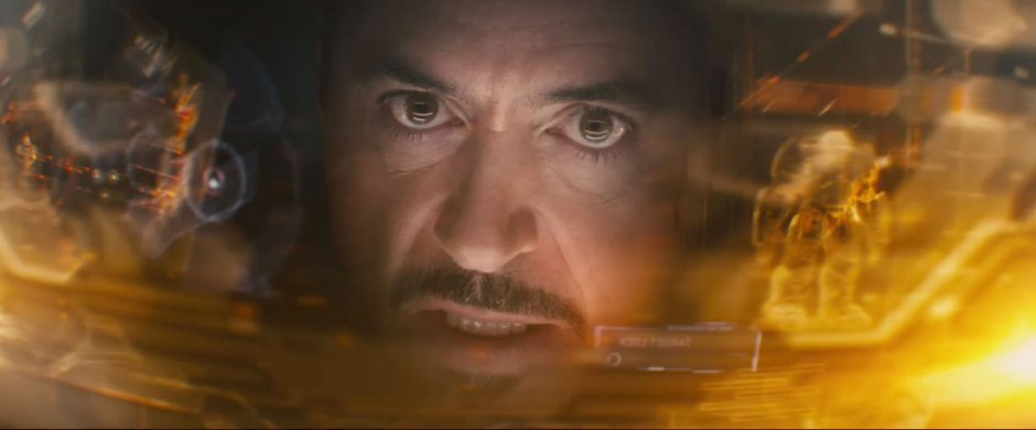 I was wrong! It's totally Tony Stark in that suit. Look at his HUD, there's even a image of the Hulkbuster, not a traditional suit.