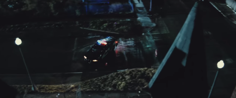 Batman Pearching with Rifle from Batman V Superman Dawn of Justice Trailer Cop Car in Gotham