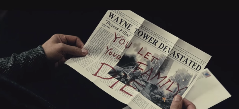 Batman Pearching with Rifle from Batman V Superman Dawn of Justice Trailer Joker Newspaper Clipping Message